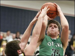 Ottawa Hills' Lucas Janowicz (35) takes a shot over Old Fort's Dalton Perry (0).