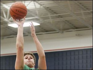 Ottawa Hills' Lucas Janowicz (35) takes a shot against  Old Fort's Dalton Perry (0).