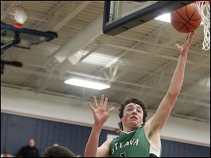 Ottawa Hills' Geoff Beans (3) takes a shot against  Old Fort's Cole Davidson (3).