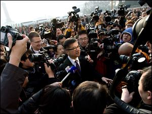 U.S. Ambassador to China Gary Locke, center, is mobbed by journalists as he attends the opening session of the annual National People's Congress at the Great Hall of the People in Beijing Tuesday.