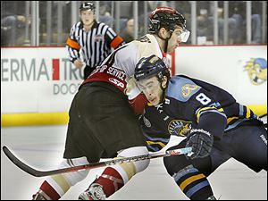 Walleye forward Trevor Parkes, right, on Tuesday was named the ECHL player of the week. In four games last week, the sec­ond-year pro tallied six goals and five as­sists.