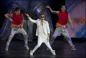 Canadian singer Justin Bieber performs at the O2 Arena in east London, Monday.