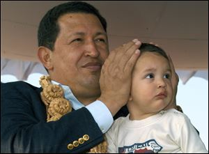 Venezuela's President Hugo Chavez, shown in this 2005 photo, died today at age 58.