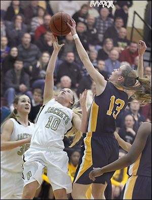 Perryburg's Abby Sattler has a shot blocked by by Notre Dame's Christy Ohlinger during their game Tuesday night. Notre Dame won and advanced to its second straight regional final.