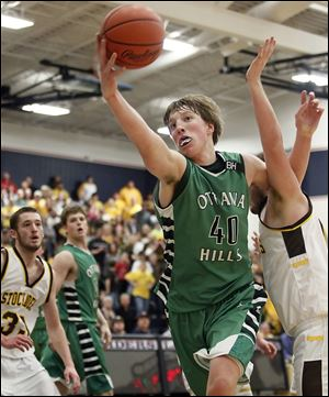 Ottawa Hills' RJ Coil (40) pulls in a rebound against Old Fort. The junior finished with 13 points and 13 rebounds in an OT win.