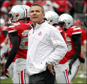 Ohio State head coach Urban Meyer surveys the crowd before playing Michigan last November.