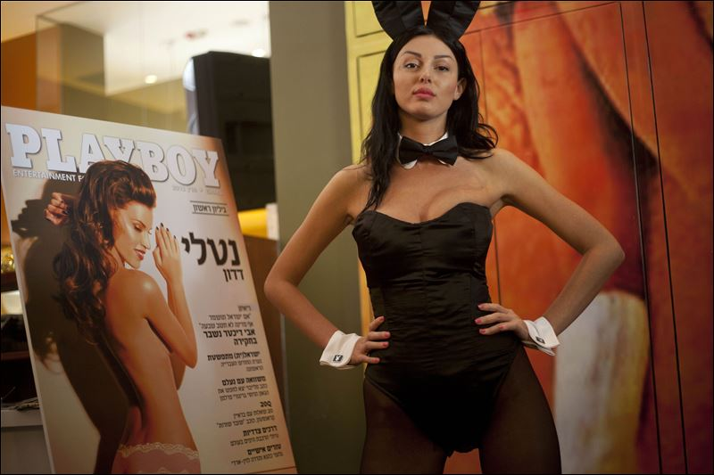 model dressed as a Playboy bunny poses with the first Hebrew