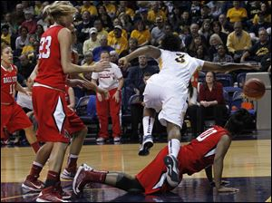 UT's Lecretia Smith dribbles over Ball State's Shanee' Jackson.