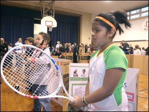 Nine year-old Ana White portrays Serena Williams during the wax museum event at Toth Elementary School in Perrysburg.