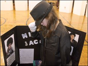 Eight-year-old Taylor Grunz portrays Michael Jackson.