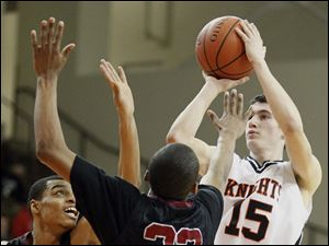 Scott's Chris Darrington (32) defends against Otsego's Jerome Griffin (15).