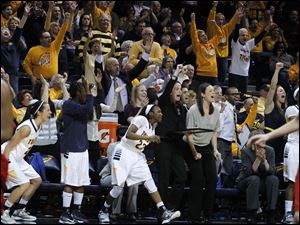 Players and fans cheer after UT's Riley McCormick hits a 3-pointer.