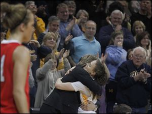 UT head coach Tricia Cullop hugs Naama Shafir on her way to the bench near the end of the game.
