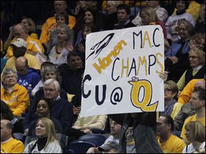 A fan holds a sign during game against Ball State with plans for next week's MAC tournament.