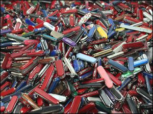 Knives of all sizes and types are piled in a box at the State of Georgia Surplus Property Division store in Tucker, Ga., and are just a few of the hundreds of items discarded at the security checkpoints of Hartsfield-Jackson Atlanta International Airport.