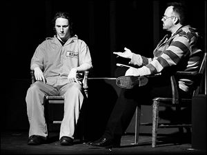 Connor Gavin plays Russell Henderson, left, being interviewed in jail by character Stephen Belber, played by Scott Heuerman, during rehearsal for the Laramie Project: 10 Years Later at the Toledo Repertoire Theatre.