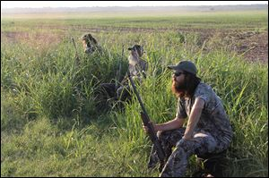 "From left, Phil Robertson, Si Robertson, and Jase Robertson in ""Duck Dynasty,"" which airing Wednesdays at 10 p.m.  on A&E."