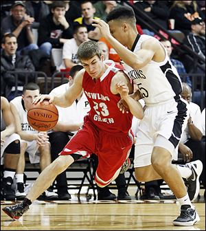 Bowling Green's Evan Gardner drives past Sandusky Perkins' Nic Williams. The Bobcats finish 14-11.