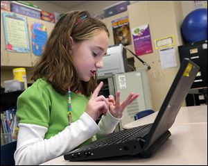 Savanna Brown, a third grader at Monroe Road Elementary School in Lambertville, figures out the answer to a math question as she and her classmates compete online against students from around the world during the World Education Games.