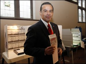 Los Angeles Mayor Antonio Villaraigosa, who will be replaced after the election, smiles at media after voting Tuesday.