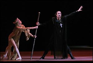 Russian dancer Pavel Dmitrichenko, as Ivan the Terrible, right, performs at a dress rehearsal of 'Ivan the Terrible' in the Bolshoi Theater in Moscow, Russia.