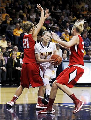Naama Shafir drives through Ball State's Lyzz Smith (21) and Katie Murphy in the senior's final regular-season game in Toledo.