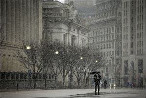 A pedestrian walks down Pennsylvania Ave near the White House in Washington, today.