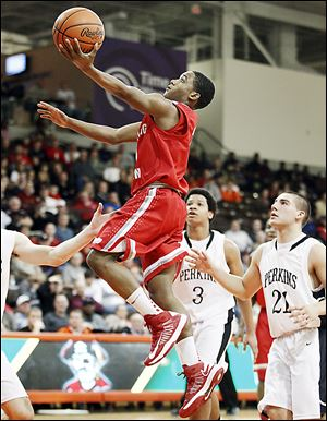 BG's LaMonta Stone takes goes to the basket in front of  Perkins' Mitchell Benkey (21) and Kyle Lewis.