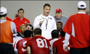 Coach Urban Meyer talks to the team during the first Ohio State football spring practice.
