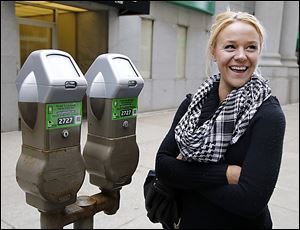 Starr Chellsea Cutino talks about downtown Toledo parking meters and a new pay-by-phone application. She was not surprised that it carries an additional fee.