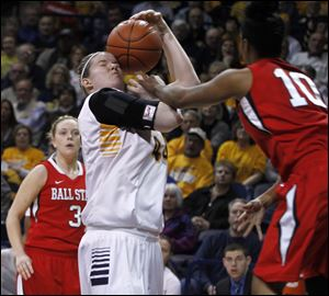 UT's Kyle Baumgartner gets the ball smacked against her face on a foul by Ball State's Shanee' Jackson tonight at Savage Arena in Toledo.