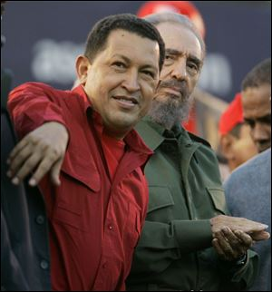 Venezuelan President Hugo Chavez, left, gestures as Cuba's President Fidel Castro looks on during an event  in Cordoba, Argentina, July, 2006.
