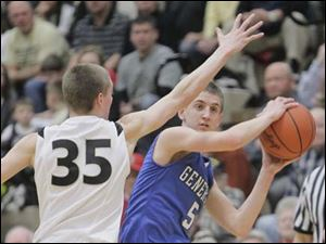 Anthony Wayne High School player Hunter Debo, 5, tries to pass around Perrysburg High School player Shane Edwards, 35.
