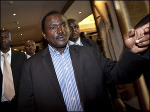 "Kalonzo Musyoka, center, Kenya's current Vice President and running mate of presidential candidate Raila Odinga, gestures as he leaves after speaking at a news conference in Nairobi. The coalition of Kenya's prime minister Raila Odinga says the vote tallying process now under way to determine the winner of the country's presidential election ""lacks integrity"", should be stopped."