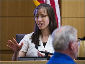 Jodi Arias answers written questions from the jury during her murder trial in Maricopa County Superior Court in Phoenix. Arias is on trial for the 2008 murder of Travis Alexander.