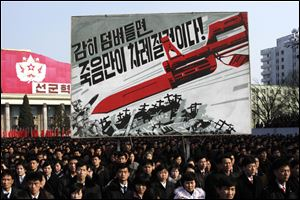 North Koreans attend a rally to support a statement given on Tuesday by a spokesman for the Supreme Command of the Korean People's Army vowing to cancel the 1953 cease-fire that ended the Korean War as well as boasting of the North's ownership of