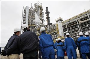 Workers and guests gather at BP-Husky Refining LLC in Oregon for a commissioning ceremony for a $400 million gasoline processing unit known there as Reformer 3. The unit went online about a month ago.