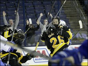Northview players celebrate their first goal during the second period.