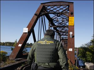 Homeland Security, under which border patrol agents such as this one at the International Railroad Bridge in Buffalo, N.Y., are facing furloughs because of the mandated federal budget cuts.