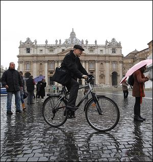 French Cardinal Philippe Barbarin crosses St. Peter's Square after a meeting.  Since Monday, cardinals have spoken on what they want to see in the next pope.