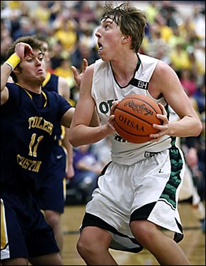 R.J. Coil, who had 27 points for Ottawa Hills, drives against Toledo Christian's Ben Ivan.