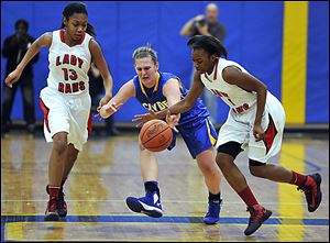 Rogers' Sasha Dailey, right, executes a steal from Clyde's Amanda Cahill as Rams  teammate Toriana Easley follows the action Friday night at Ontario High School in a regional final game.