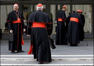 Cardinal Gianfranco Ravasi, left, joins other cardinals as he arrives at the Vatican. The cardinals plan to keep meeting before the start of Tuesday's papal conclave.