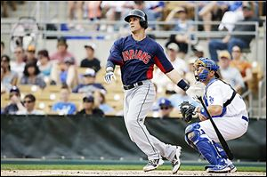 The Indians' Yan Gomes doubles against the Dodgers earlier this week. He is hitting .412 on the spring.