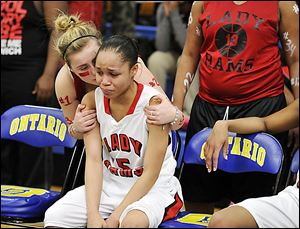 Keyanna Austin gets support from a fan after Rogers lost to Clyde in a Division II regional final. The Rams finish 22-4.