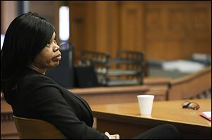 Melody Williams listens to Ian English, an assistant Lucas County prosecutor, during closing arguments. Williams was convicted on all counts in the murder of L.C. Lyons, Jr., of Sylvania Township.