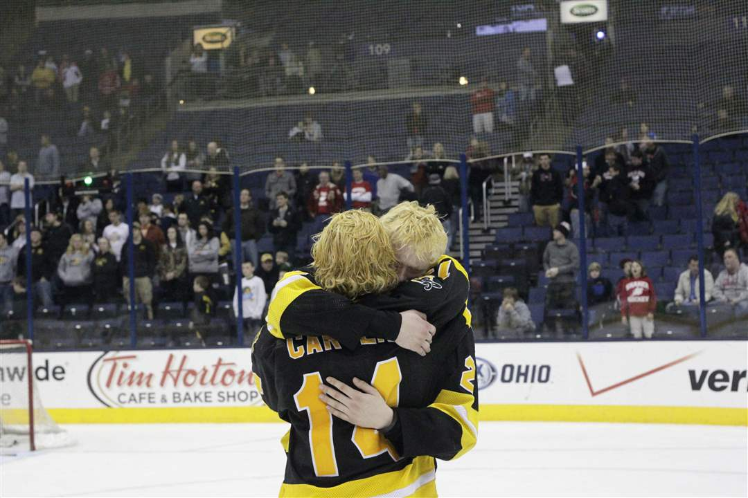 State-hockey-hugs