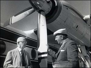 cty EXECUTIVE JETS     BLADE PHOTO June 7, 1972    Champion Spark Plug executives Harry Arher, left, and John Nopper stand by the company's Fairchild Turboprop.
