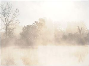 Foggy Autumn dawn at Quarry Pond in Indiana.