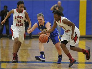 Sasha Dailey (1) steals the ball from Clyde's Amanda Cahill as teammate Toriana Easley looks on.